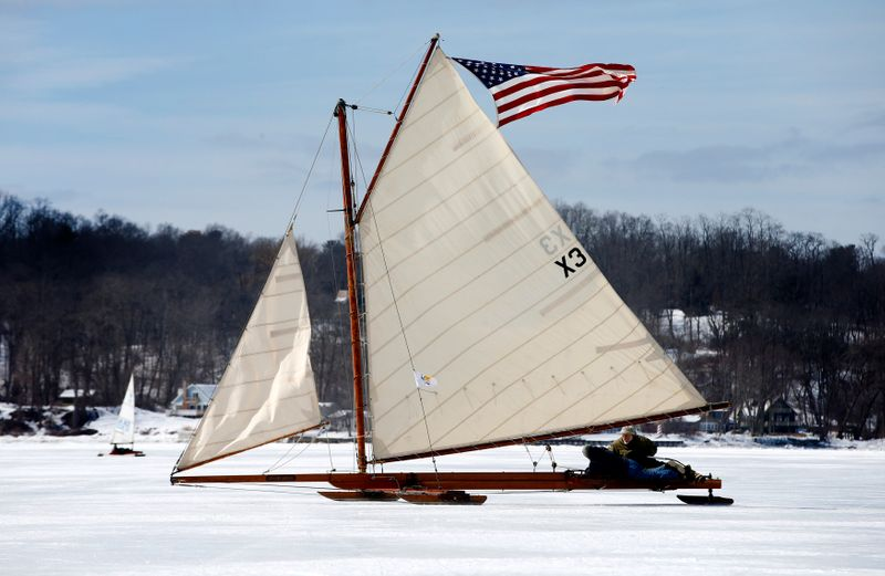 FILE PHOTO: Antique ice sailboats from the Hudson River Ice Yacht Club's sail on the frozen upper Hudson River near, Astor Point in Barrytown, New York