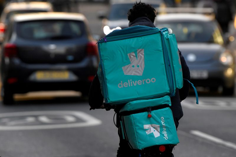 FILE PHOTO: Deliveroo delivery rider cycles in London, Britain