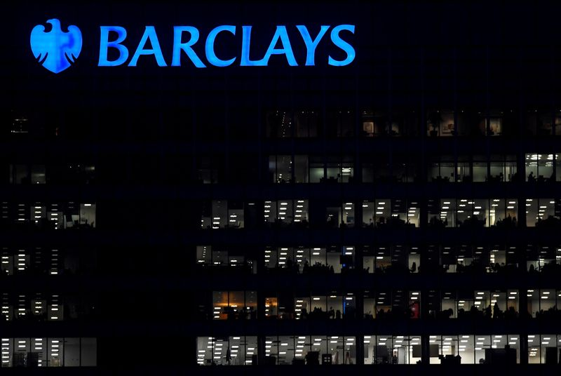 FILE PHOTO: Workers are seen at Barclays bank offices in the Canary Wharf financial district in London