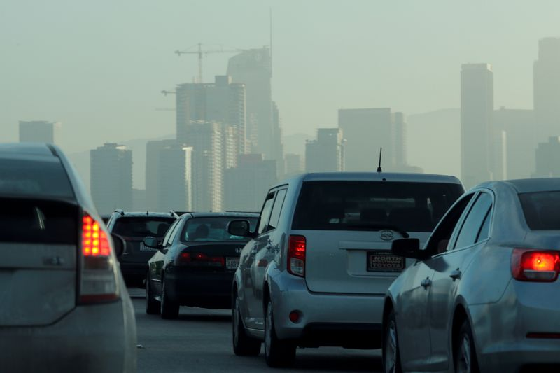 FILE PHOTO: FILE PHOTO: Commuters navigate early morning traffic as they drive towards downtown in Los Angeles, California