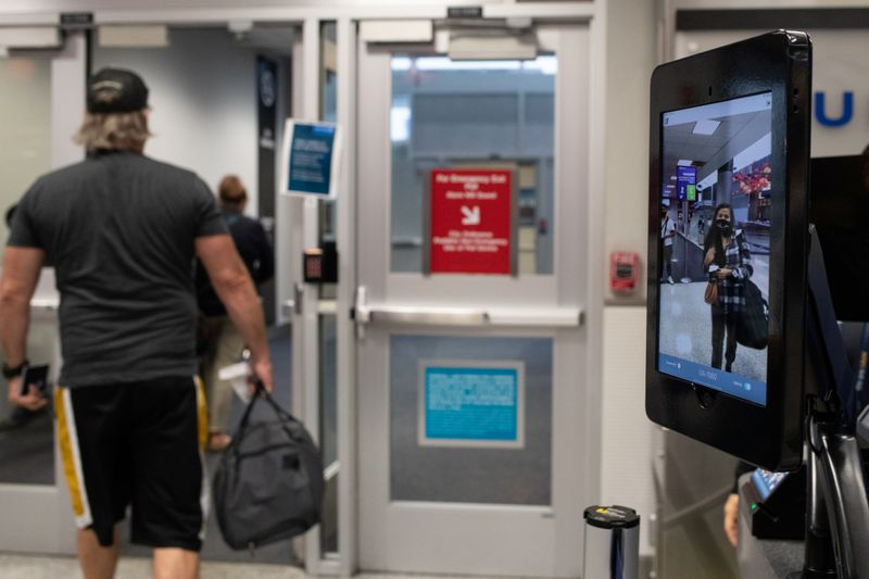 A passenger walks up to use biometric boarding at IAH George Bush Intercontinental Airport in Houston