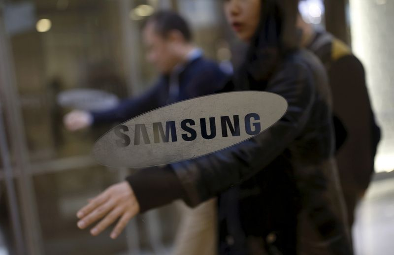 FILE PHOTO: Employees walking in the main office building of Samsung Electronics in Seoul