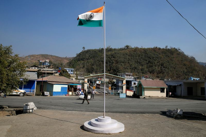 An Indian national flag flies next to an immigration check post on the India-Myanmar border in Zokhawthar village