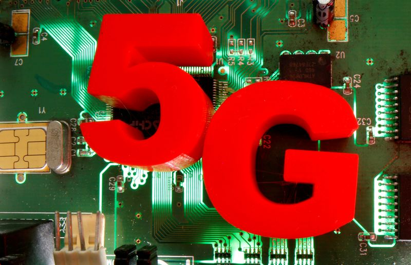 FILE PHOTO: 3d printed objects representing 5G are put on a motherboard in this picture illustration