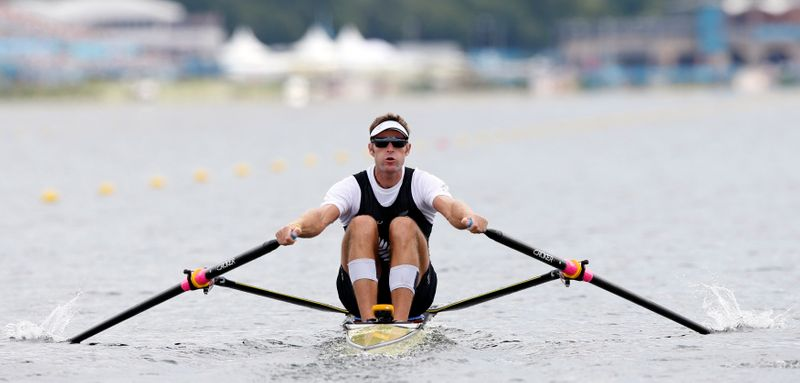 New Zealand's Mahe Drysdale rows during the men's rowing single sculls heat at the Eton Dorney during the London 2012 Olympic Games