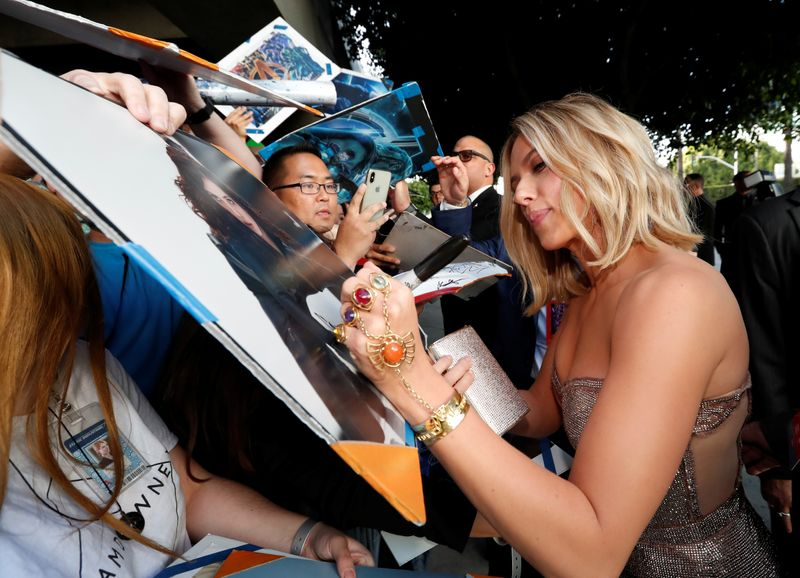 FILE PHOTO: Cast member Scarlett Johannsson signs autographs on the red carpet at the world premiere of the film