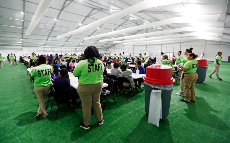 FILE PHOTO: Staff oversee breakfast at the U.S. government's government's newest holding center for migrant children in Carrizo Springs