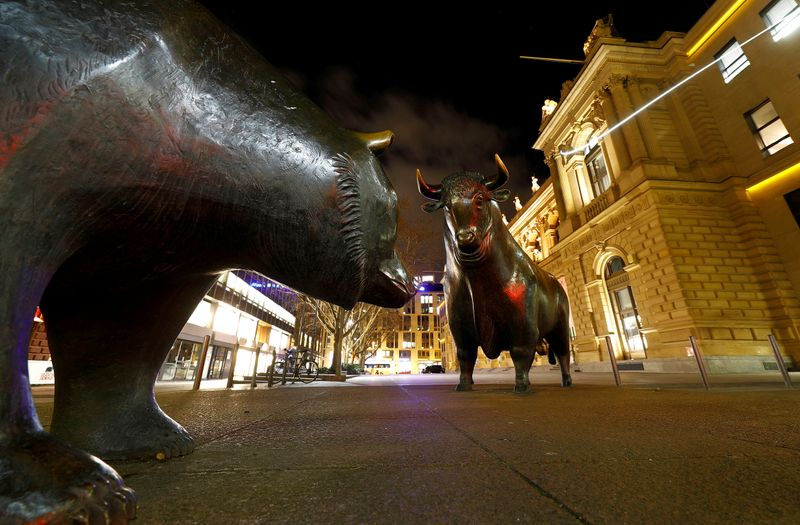 FILE PHOTO: Bull and bear symbols for successful and bad trading are seen in front of the German stock exchange (Deutsche Boerse) in Frankfurt