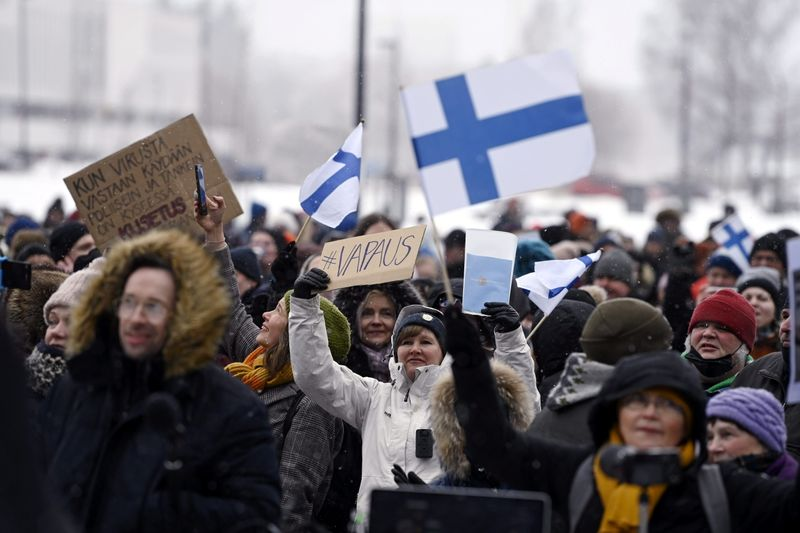 FILE PHOTO: People protest against Finnish government's regulations to fight the coronavirus disease (COVID-19) pandemic, in Helsinki