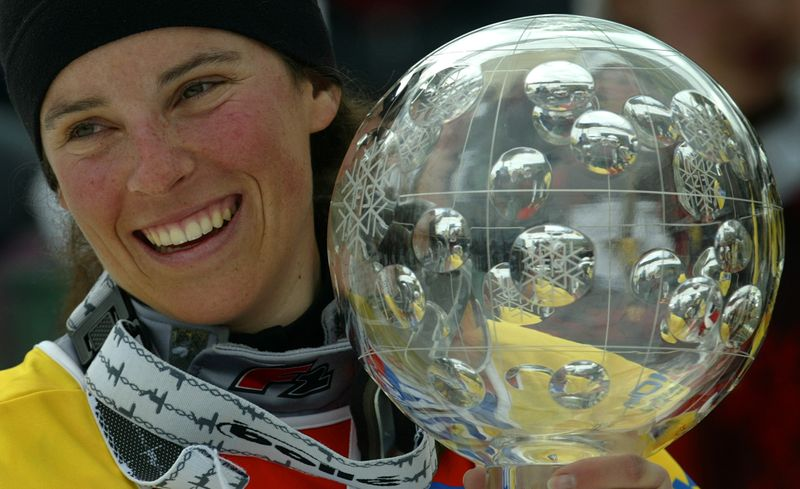 FILE PHOTO: FRANCE'S POMAGALSKI HOLDS HER WORLD CUP TROPHY AT THE ALPINE SKIING WORLD CUP FINALS IN BARDONECCHIA.