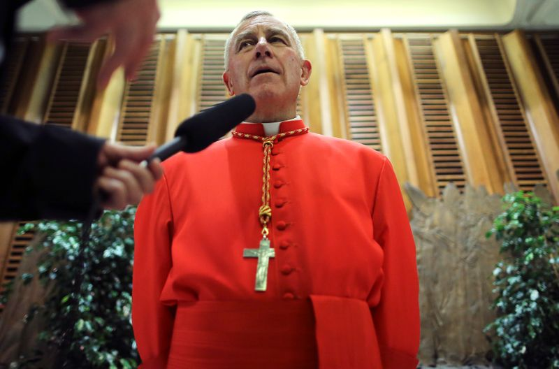 FILE PHOTO: Newly elevated Cardinal John Atcherley Dew speaks with journalist after taking part in the Consistory at the Vatican