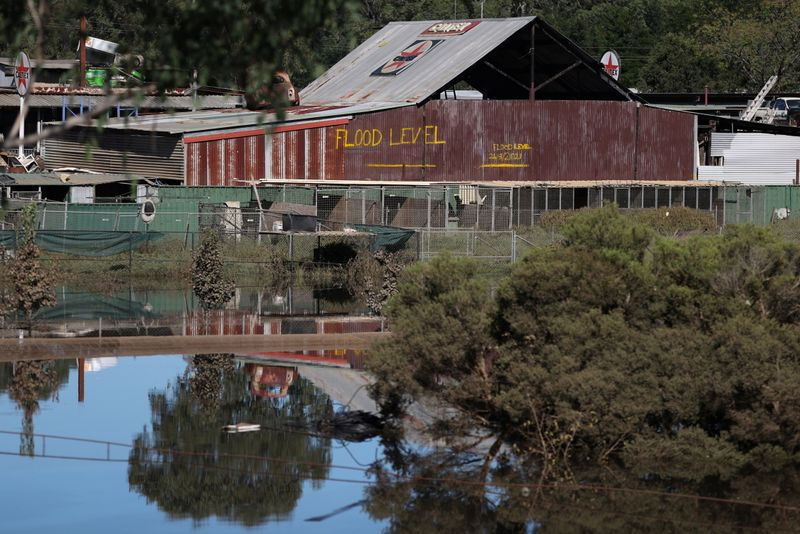 A marking on the side of a barn indicates where flood levels peaked following prolonged rains in Sydney