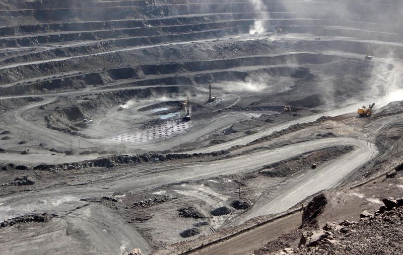 FILE PHOTO: Miners are seen at the Bayan Obo mine containing rare earth minerals, in Inner Mongolia