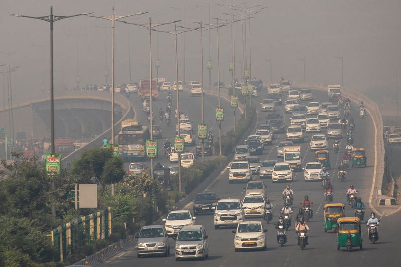 FILE PHOTO: Traffic moves on a smoggy morning in New Delhi