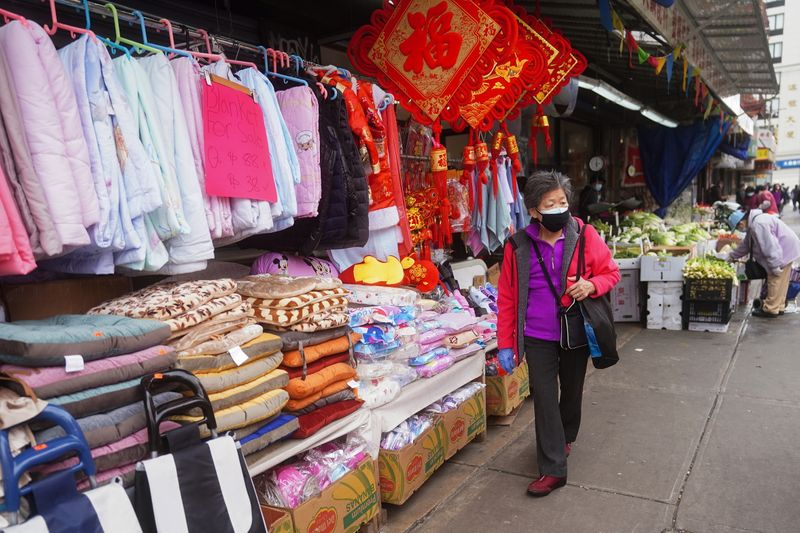A woman shops in Chinatown in New York City