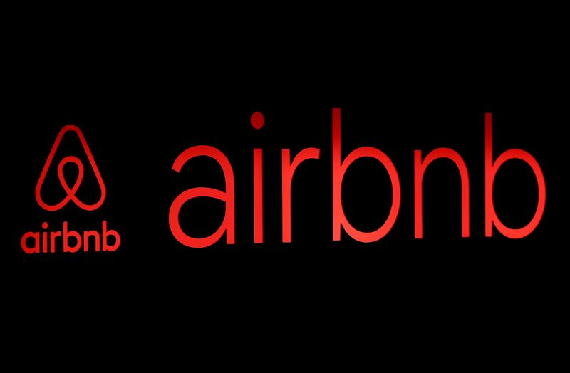 FILE PHOTO: FILE PHOTO: The logos of Airbnb are displayed at an Airbnb event in Tokyo