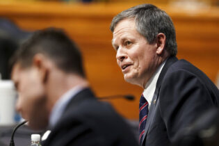 Sen. Steve Daines, R-Mont., speaks during a Senate Finance Committee hearing on the nomination of Xavier Becerra to be Secretary of Health and Human Services on Capitol Hill in Washington, Wednesday, Feb. 24, 2021. (Greg Nash/Pool via AP)