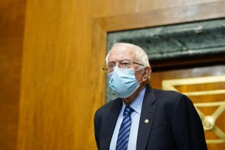 Senate Budget Committee Chairman Sen. Bernie Sanders, I-Vt., arrives for a hearing on Capitol Hill in Washington, Thursday, Feb. 25, 2021, examining wages at large profitable corporations. (AP Photo/Susan Walsh, Pool)
