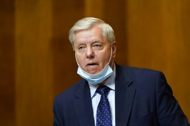 Senate Budget Committee ranking member Sen. Lindsey Graham, R-S.C., arrives for a hearing on Capitol Hill in Washington, Thursday, Feb. 25, 2021, examining wages at large profitable corporations. (AP Photo/Susan Walsh, Pool)