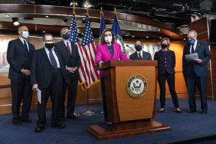 House Speaker Nancy Pelosi of Calif., center, speaks about the Congress Equality Act, Thursday, Feb. 25, 2021, with from left, Sen. Cory Booker, D-N.J., Sen. Jerry Nadler, D-N.Y., Sen. Jeff Merkley, D-Ore., Pelosi, Rep. David Cicilline, D-R.I., Sen. Tammy Baldwin, D-Wis., and Senate Majority Leader Chuck Schumer, D-N.Y., on Capitol Hill in Washington. (AP Photo/Jacquelyn Martin)