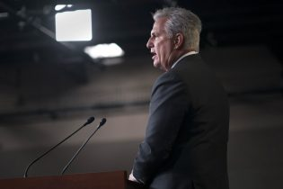 House Minority Leader Kevin McCarthy, R-Calif., criticizes Speaker of the House Nancy Pelosi, D-Calif., and the Democratic $1.9 trillion COVID relief package, during a news conference at the Capitol in Washington, Friday, Feb. 26, 2021. (AP Photo/J. Scott Applewhite)