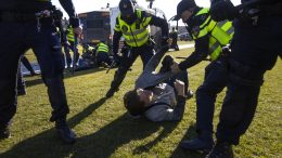Dutch police arrested several demonstrators as they broke up a demonstration of several hundreds of people who protested against the coronavirus lockdown and curfew on Museum Square in Amsterdam, Netherlands, Sunday, Feb. 28, 2021. (AP Photo/Peter Dejong)