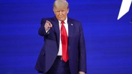 Former president Donald Trump points to cheering supporters as he is introduced before speaking at the Conservative Political Action Conference (CPAC) Sunday, Feb. 28, 2021, in Orlando, Fla. (AP Photo/John Raoux)