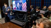 Joe Biden holds a virtual meeting with Mexican President Andres Manuel Lopez Obrador, pictured on screen, in the Roosevelt Room of the White House, Monday, March 1, 2021, in Washington. (AP Photo/Andrew Harnik)