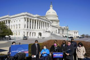Resident Commissioner Jenniffer Gonzalez-Colon, who represents Puerto Rico as a nonvoting member of Congress, speaks during a news conference on Puerto Rican statehood on Capitol Hill in Washington, Tuesday, March 2, 2021. (AP Photo/Patrick Semansky)