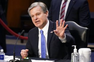 """FBI Director Christopher Wray testifies before the Senate Judiciary Committee on Capitol Hill in Washington, Tuesday, March 2, 2021. Wray is condemning the Jan. 6 riot at the Capitol as """"domestic terrorism."""" (AP Photo/Patrick Semansky)"""