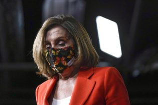 House Speaker Nancy Pelosi of Calif., walks onstage during a news conference before participating in the House Democratic Issues Conference on Capitol Hill in Washington, Tuesday, March 2, 2021. (AP Photo/Patrick Semansky)