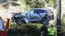 "FILE - In this Feb. 23, 2021, file photo, a crane is used to lift a vehicle following a rollover accident involving golfer Tiger Woods, in the Rancho Palos Verdes suburb of Los Angeles. Detectives are looking at data from the so-called ""black box"" of Tiger Woods' SUV to get a clearer picture of what occurred during the Southern California rollover crash last week that seriously injured the golf star, authorities said Wednesday, March 3. (AP Photo/Ringo H.W. Chiu, File)"