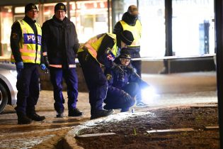 "Police are seen in the area after several people were attacked in Vetlanda, Sweden, Wednesday, March 3, 2021. Swedish police say a man has assaulted at least eight people in a southern Sweden town, and that the case was being investigated as ""a suspected terrorist crime."" Police said a man in his 20s attacked people in the small town of Vetlanda, about 190 kilometers (118 miles) southeast of Goteborg, Sweden's second largest city. (Mikael Fritzon/TT News Agency via AP)"