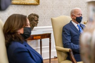 President Joe Biden and Vice President Kamala Harris meet with members of the House of Representatives in the Oval Office of the White House in Washington, Thursday, March 4, 2021, on infrastructure. (AP Photo/Andrew Harnik)