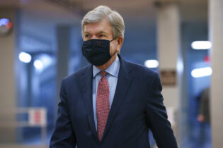 Sen. Roy Blunt, R-Mo., heads to the chamber as the Senate holds a voting marathon on the Democrats' $1.9 trillion COVID-19 relief bill that's expected to end with the chamber's approval of the measure, at the Capitol in Washington, Friday, March 5, 2021. (AP Photo/J. Scott Applewhite)