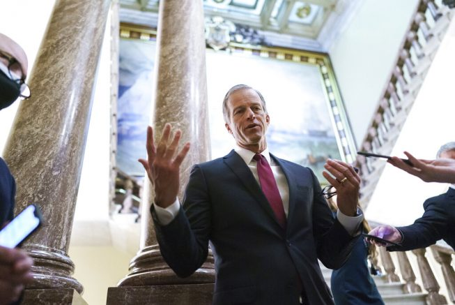 Senate Minority Whip John Thune, R-S.D., talks with reporters during a delay in work on the Democrats' $1.9 trillion COVID-19 relief bill, at the Capitol in Washington, Friday, March 5, 2021. (AP Photo/J. Scott Applewhite)