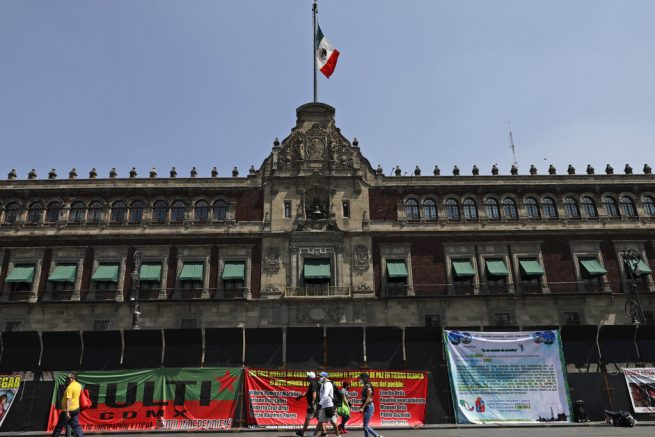 Banners with messages directed at Mexico's President Andres Manuel Lopez Obrador hang from a perimeter fence set up in front of the National Palace as preparation for the upcoming International Women's Day demonstration, in Mexico City, Friday, March 5, 2021. Marked on March 8th, the day has been sponsored by the United Nations since 1975, to celebrate women's achievements and aims to further their rights. (AP Photo/Eduardo Verdugo)