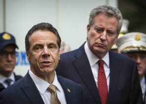 """FILE - This photo from Wednesday, Oct. 24, 2018, shows Mayor Bill de Blasio right, and Gov. Andrew Cuomo, left, holding a news conference in New York. De Blasio said he watched the CBS interview Thursday with Cuomo accuser Charlotte Bennett and said he found her """"just 100% believable."""" Bennett, 25, is accusing Gov. Cuomo of sexual harassment when she worked as his aide. (AP Photo/Kevin Hagen, File)."""
