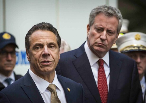 "FILE - This photo from Wednesday, Oct. 24, 2018, shows Mayor Bill de Blasio right, and Gov. Andrew Cuomo, left, holding a news conference in New York. De Blasio said he watched the CBS interview Thursday with Cuomo accuser Charlotte Bennett and said he found her ""just 100% believable."" Bennett, 25, is accusing Gov. Cuomo of sexual harassment when she worked as his aide. (AP Photo/Kevin Hagen, File)."