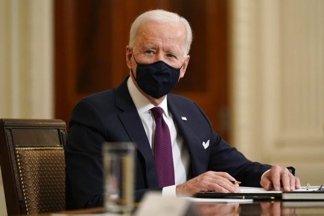 Joe Biden participates in a roundtable discussion on a coronavirus relief package in the State Dining Room of the White House in Washington, Friday, March 5, 2021. (AP Photo/Patrick Semansky)