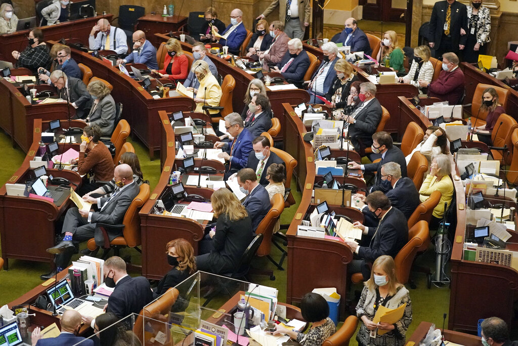 The Utah House of Representatives work on the House floor Friday night, March 5, 2021, in Salt Lake City. The Utah Legislature is wrapping up its business for the year Friday evening. Lawmakers have already tackled a number of issues this year during a session that was conducted partially remotely because of the coronavirus pandemic. (AP Photo/Rick Bowmer)
