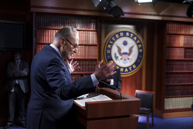 Senate Majority Leader Chuck Schumer, D-N.Y., praises his Democratic Caucus at a news conference just after the Senate narrowly approved a $1.9 trillion COVID-19 relief bill, at the Capitol in Washington, Saturday, March 6, 2021. Senate passage sets up final congressional approval by the House next week so lawmakers can send it to President Joe Biden for his signature. (AP Photo/J. Scott Applewhite)