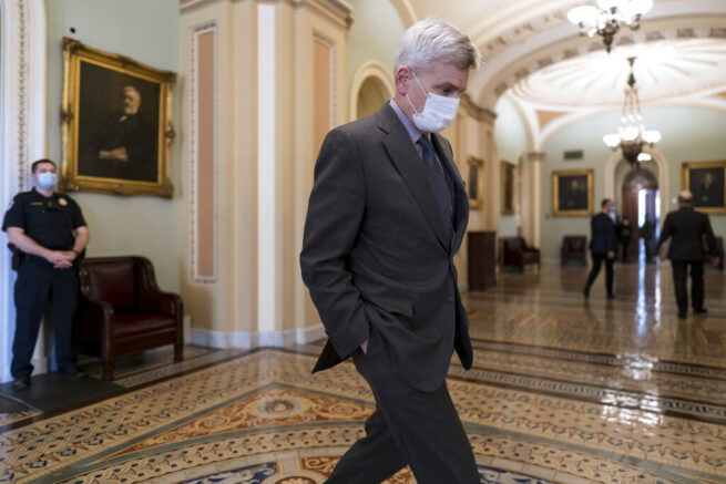 Sen. Bill Cassidy, R-La., leaves the chamber just after passage of the Democrat's $1.9 trillion COVID-19 relief bill, at the Capitol in Washington, Saturday, March 6, 2021. The bill was narrowly passed, setting up final congressional approval by the House next week so lawmakers can send it to President Joe Biden for his signature. (AP Photo/J. Scott Applewhite)