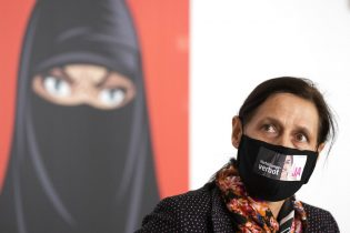 Monika Ruegsegger-Hurschler, National Councillor SVP, gives an interview at the meeting place of the supporters of the initiative to ban face coverings, in Bern on Sunday March 7, 2021. Swiss voters appeared on course Sunday to narrowly approve a proposal to ban face coverings, both the niqabs and burqas worn by a few Muslim women in the country and the ski masks and bandannas used by protesters. (Peter Klaunzer/Keystone via AP)