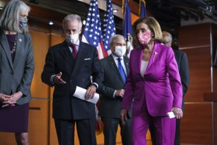 Speaker of the House Nancy Pelosi, D-Calif., joined from left by Rep. Katherine Clark, D-Mass., Ways and Means Committee Chairman Richard Neal, D-Mass., Budget Committee Chairman John Yarmuth, D-Ky., and Majority Whip James Clyburn, D-S.C., finishes a news conference ahead of the vote on the Democrats' $1.9 trillion COVID-19 relief bill, at the Capitol in Washington, Tuesday, March 9, 2021. (AP Photo/J. Scott Applewhite)