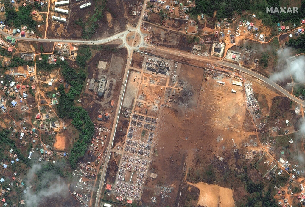 This handout satellite photo provided by Maxar Technologies shows a military garrison after an explosion, in Bata, Equatorial Guinea, Tuesday, March 9, 2021. The government of Equatorial Guinea says the death toll from a series of explosions at a military barracks has risen by dozens to at least 98 killed after more bodies were recovered. The blasts on Sunday in the neighborhood of Mondong Nkuantoma in the coastal city of Bata also wounded more than 600 people. (Maxar Technologies via AP)