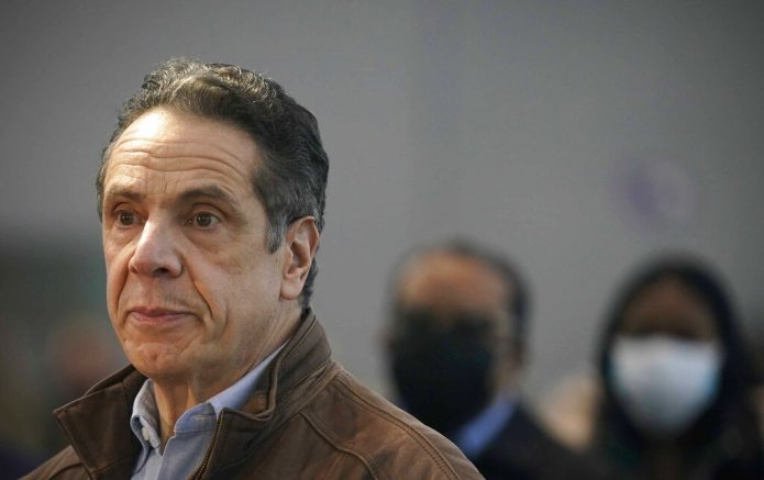 FILE - This Monday, March 8, 2021, file photo shows New York Gov. Andrew Cuomo speaking at a vaccination site in New York. A sixth woman has come forward alleging that Cuomo inappropriately touched her late last year, during an encounter at the governor's mansion. (AP Photo/Seth Wenig, Pool, File)