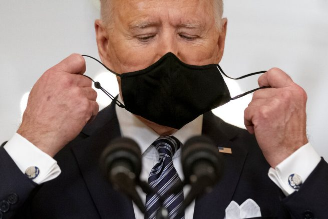 President Joe Biden takes off his mask to speak about the COVID-19 pandemic during a prime-time address from the East Room of the White House, Thursday, March 11, 2021, in Washington. (AP Photo/Andrew Harnik)
