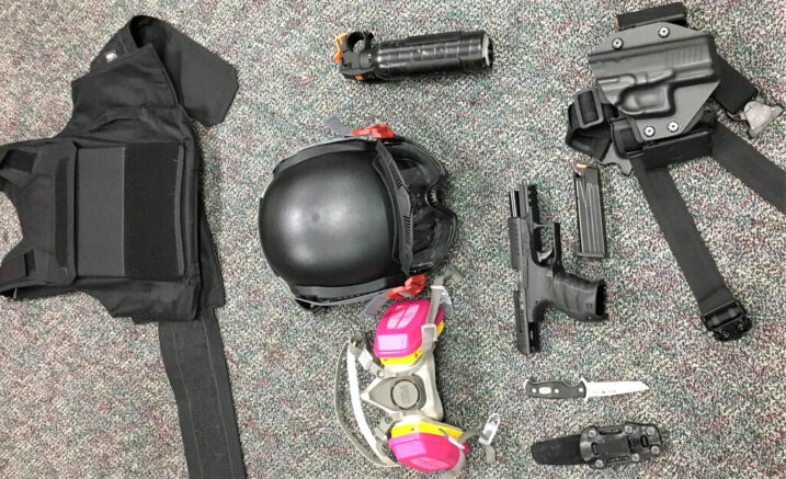 This Friday, March 12, 2021, photo released by Portland Police Bureau shows numerous items left behind by people inside the perimeter of a march, including a crowbar, hammers, bear spray, slugging weapon with rocks, high impact slingshot, and knives, after they corralled a group of about 100 hundred protesters Friday night in Portland, Ore. On Saturday, March 13, 2021, police said officers surrounded protesters about 15 minutes after the march began in the city's Pearl District at 9 p.m. because some began smashing windows. (Portland Police Department via AP)