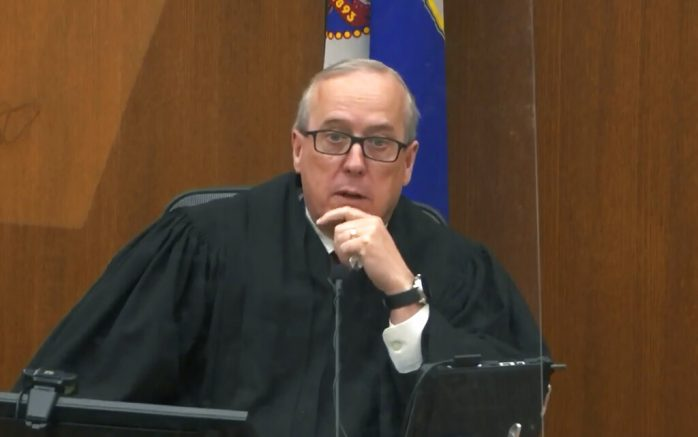 In this image taken from video, Hennepin County Judge PeterCahill presides over pre-trial motions, prior to continuing jury selection, Monday, March 15, 2021, in the trial of former Minneapolis police officer Derek Chauvin, at the Hennepin County Courthouse in Minneapolis, Minn. Chauvin is charged in the May 25, 2020, death of George Floyd (Court TV/Pool via AP)
